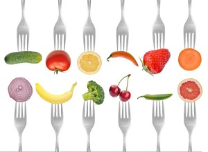 vegetables and fruits on the collection of forks, diet concept